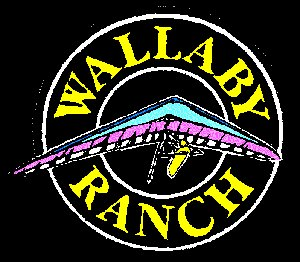 The Wallaby Ranch logo. The logo is on a black background, circular in shape and has yellow text with a hang glider in the middle